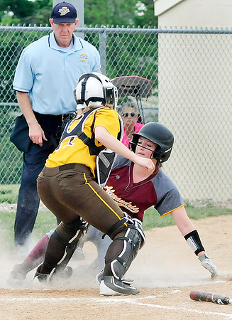 John P. Cleary   The Herald Bulletin<br /> Alexandria's Kirsten Vanhorn slides under the tag by Monroe Central's catcher, Mabrey Buis, to score on an infield hit in the third inning.