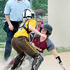 John P. Cleary | The Herald Bulletin<br /> Alexandria's Kirsten Vanhorn slides under the tag by Monroe Central's catcher, Mabrey Buis, to score on an infield hit in the third inning.