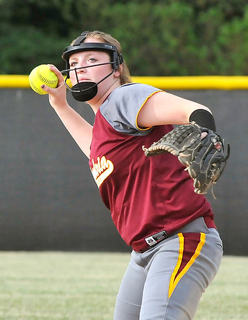 John P. Cleary   The Herald Bulletin<br /> Alexandria's Kirsten Vanhorn eyes her target as she throws to first base on an infield grounder.