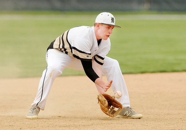 Don Knight   The Herald Bulletin<br /> Daleville's Max Stecher fields the ball as the Broncos hosted Wapahani on Wednesday.