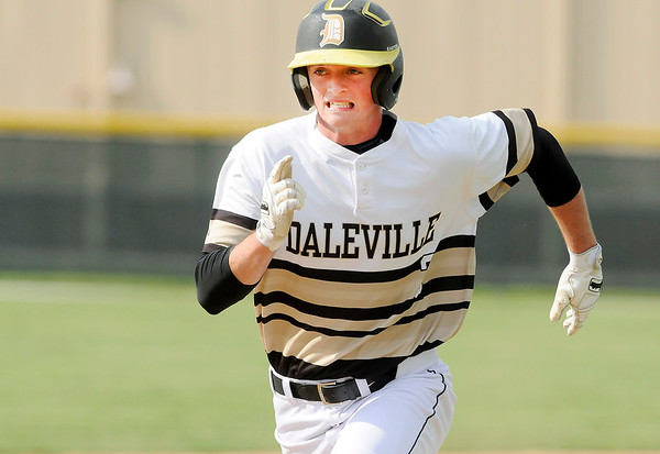 Don Knight | The Herald Bulletin<br /> Daleville's Josh Price runs to third base as the Broncos hosted Wapahani on Wednesday.
