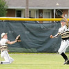Don Knight | The Herald Bulletin<br /> Daleville's Ryan Hale catches a fly ball as he is backed up by Jimmy Bowen as the Broncos hosted Wapahani on Wednesday.