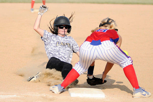 Don Knight | The Herald Bulletin<br /> Lapel's Kylie Ritch beats the throw to Elwood's Holy Sallee at third base in the second day of sectional action on Tuesday.
