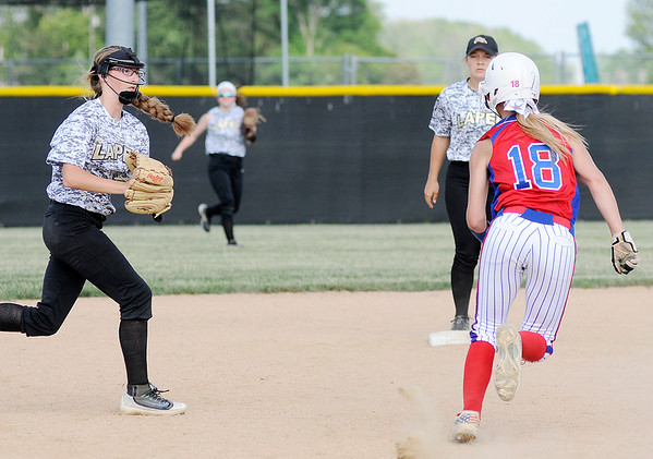 Don Knight | The Herald Bulletin<br /> Lapel's Chloe Tucker tags Elwood's Emily Booker out as she tries to get back to second base during the second day of sectional action on Tuesday.