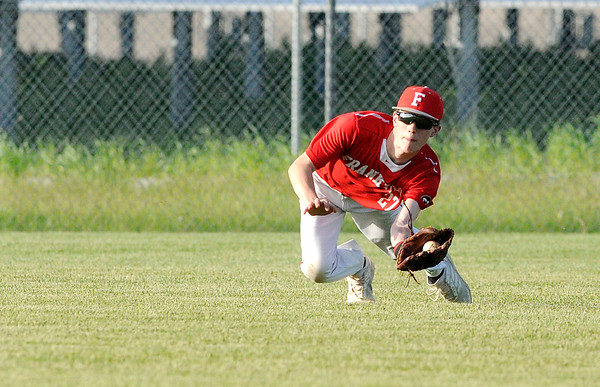 Don Knight | The Herald Bulletin<br /> Frankton's Sam Dalton makes a diving catch in the outfield as the Eagles faced Shenandoah in the sectional at Lapel on Wednesday.
