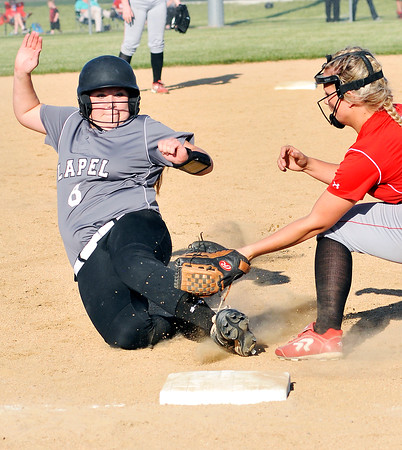 John P. Cleary | The Herald Bulletin<br /> Lapel's Hannah Harless slides into third just as Frankton's Ashtyn Rastetter puts the tag on her leg in the 7th inning. Harless was trying to stretch her hit into a triple but was called out.