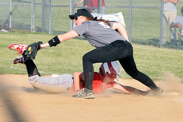 John P. Cleary | The Herald Bulletin Frankton's Maddie Granger just gets back to first base as Lapel's McKenzie Land stretches for the ball in the 7th inning.