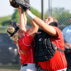 John P. Cleary | The Herald Bulletin<br /> Frankton's Ashtyn Rastetter and Tia Sharp collide while going after a foul ball knocking the ball loose and continuing the inning for Lapel in the 5th inning of their sectional game.
