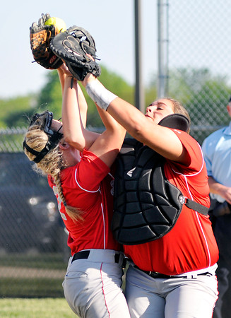 John P. Cleary | The Herald Bulletin Frankton's Ashtyn Rastetter and Tia Sharp collide while going after a foul ball knocking the ball loose and continuing the inning for Lapel in the 5th inning of their sectional game.