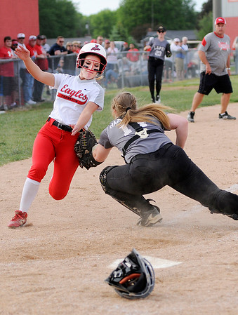 Don Knight | The Herald Bulletin<br /> Lapel catcher Jasmine Hazelbaker tags Brooke Campbell out at home plate as the Eagles hosted the Bulldogs in the Sectional 40 semifinal on Tuesday.