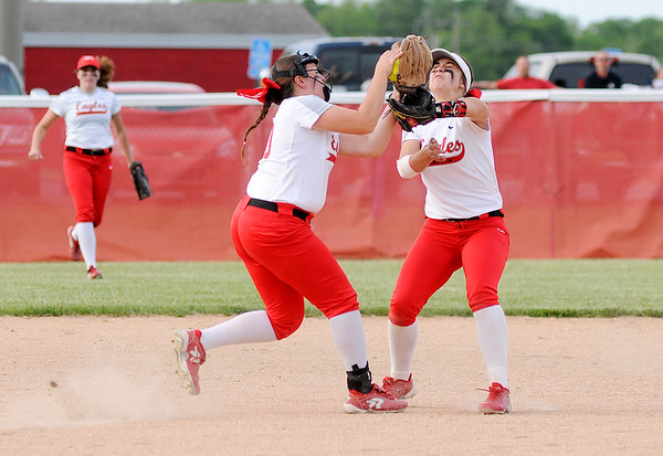 Don Knight | The Herald Bulletin<br /> Frankton's Maddie Granger, left, catches the ball as she collides with Maycee Mallernee as the Eagles hosted Lapel in the Sectional 40 semifinal on Tuesday.
