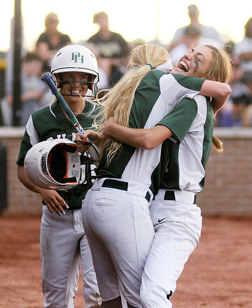 Don Knight | The Herald Bulletin<br /> Pendleton Heights' Amanda White celebrates hitting a home run to keep the Arabians alive in the bottom of the seventh as they faced Mt. Vernon in the sectional championship on Thursday.