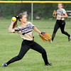 Don Knight | The Herald Bulletin<br /> Daleville's Lacie Roberts throws after fielding the ball in the outfield as Liberty Christian hosted the Broncos during the softball sectional on Tuesday.