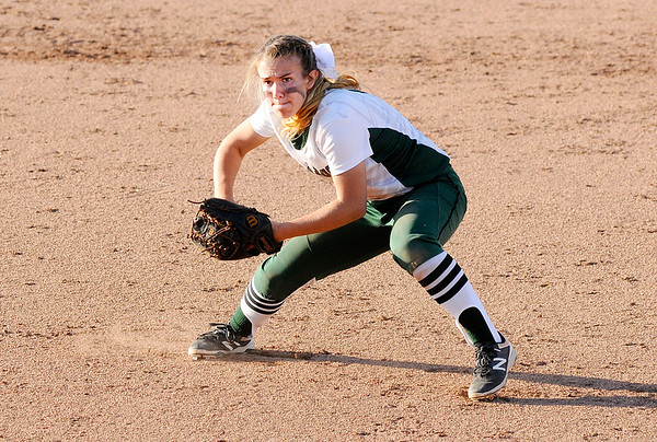 Don Knight | The Herald Bulletin<br /> Pendleton Heights' Mickala Winans looks to throw to first after fielding the ball as the Arabians hosted the Anderson Indians in the softball sectional final on Thursday.