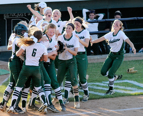 Don Knight | The Herald Bulletin<br /> The Pendleton Heights Arabians surround pitcher Jordan Benefiel after their 2-1 win over the Anderson Indians in the softball sectional final on Thursday. Benefiel set a season high with 14 strikeouts Thursday.