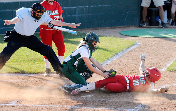 Don Knight | The Herald Bulletin<br /> Anderson's Sierra Cunningham steals home in the softball sectional final on Thursday.