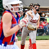 Frankton's pitcher Adyson Coppess throws to first base as Elwood base runner Kaylee Guillemette runs out the grounder in the 4th inning. Guillemette beat the throw and was safe at first.