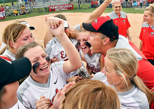 Frankton players and head coach Jeremy Parker celebrate their 2A sectional softball win over Elwood Thursday evening 3-1.