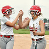 Frankton's Makena Alexander, right, gets congratulated by her teammates after blasting a 3 run homer in the third inning break up a scoreless game.