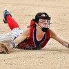 Elwood's Nevaeh Powell makes a diving stop of a hard hit grounder then tosses the runner out at first base in the 5th inning.