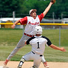 John P. Cleary | The Herald Bulletin<br /> Frankton's JJ Hatzell stretches to catch the ball as Lapel's Mason Gilley slides into second base to be forced out in the second inning.