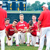 John P. Cleary |  The Herald Bulletin<br /> Frankton's head coach Brad Douglas, right-standing, talks to his players in the outfield after they lost the 2A Lapel sectional championship game to Wapahani 4-2.