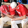 John P. Cleary |  The Herald Bulletin<br /> Frankton's Travis McGuire, right, consoles teammate Connor Love after he grounded out in the seventh inning and Frankton lost to Wapahani 4-2.