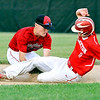 John P. Cleary |  The Herald Bulletin<br /> Wapahani's Alec Summers puts the tag on Frankton's runner Sabastian Davis as he slides into second base on a steal attempt. The hard slide by Davis knocked the ball loose and was called safe on the play.