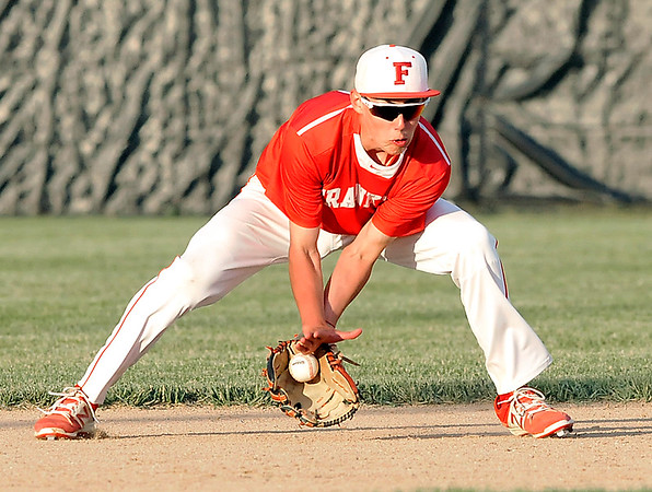 John P. Cleary |  The Herald Bulletin<br /> Frankton's JJ Hatzell scoops up a hard grounder to throw the runner out at first base.