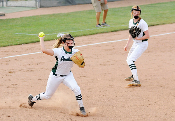 Don Knight | The Herald Bulletin<br /> Pendleton Heights' Lauren Landes attempts to throw a base runner out at first after catching a bunt that was popped up as the Arabains hosted Cathedral in the regional on Tuesday.