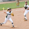 Don Knight   The Herald Bulletin<br /> Pendleton Heights' Lauren Landes attempts to throw a base runner out at first after catching a bunt that was popped up as the Arabains hosted Cathedral in the regional on Tuesday.