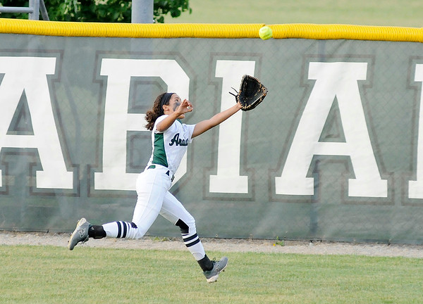 Don Knight | The Herald Bulletin<br /> Pendleton Heights' Jayden Brown catches a fly ball in the outfield as the Arabians hosted Cathedral in the regional on Tuesday.