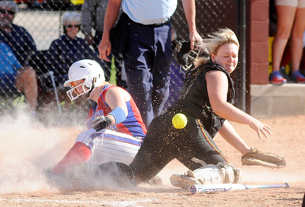 Don Knight | The Herald Bulletin<br /> Elwood's Shantel Blackford scores on a suicide squeeze as the ball gets past Alexandria's Mikaylah Murphy in the regional at Alexandria on Tuesday.