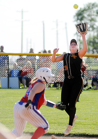 Don Knight | The Herald Bulletin<br /> Alexandria's Mackenzie McCarty catches a fly ball as the Tigers hosted the Elwood Panthers in the regional on Tuesday.