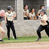 Don Knight | The Herald Bulletin<br /> Madison-Grant coach Danny Justus sends base runner Ellie Alcala home as the Argylls hosted the Alexandria Tigers on Thursday.