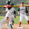 Don Knight | The Herald Bulletin<br /> Anderson's Brayden Waymire looks to throw to first for a double play after taging Pendleton Heights' Wyatt Douglas out getting the Indians out of the bottom of the third with the bases loaded on Wednesday.