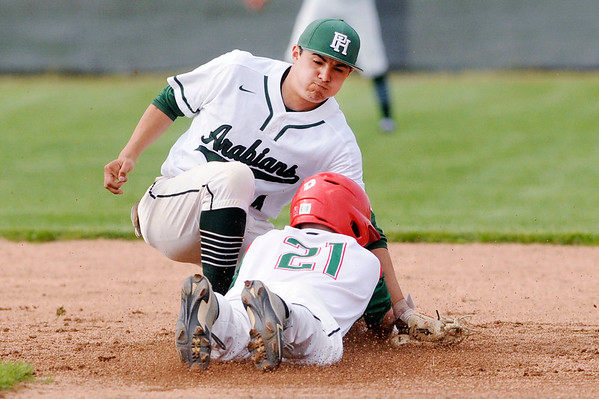 Don Knight | The Herald Bulletin<br /> Pendleton Heights' Rene Casas tags Anderson's Mercklin DeWitt out as he attempts to steal second as the Arabians  hosted Anderson at Bill Stoudt Field on Wednesday.