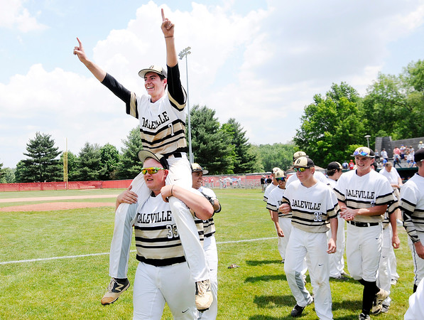 Don Knight   The Herald Bulletin<br /> Daleville's Bryce Wright carries Brandon Vermillion on his shoulders after the Broncos 2-1 win over Blackhawk Christian in the semistate at Plymouth on Saturday.