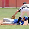 Don Knight | The Herald Bulletin<br /> Daleville's TJ Price tags Blackhawk Christian's Kole Barkhaus out as he attempts to steal second during the semistate at Plymouth on Saturday.