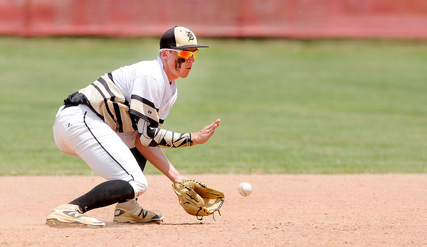 Don Knight   The Herald Bulletin<br /> Daleville's TJ Price fields the ball as the Broncos beat Blackhawk Christian in the semistate at Plymouth on Saturday.
