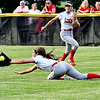 Frankton's right fielder Alivia Swisher makes a diving attempt to catch this fly ball in the sixth inning. The ball popped out of the glove and the runner was safe.