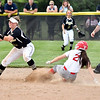 Frankton's Jersey Marsh slides into second as Sarah Duncan of Madison-Grant catches the ball. Marsh was called safe on the sixth inning play.
