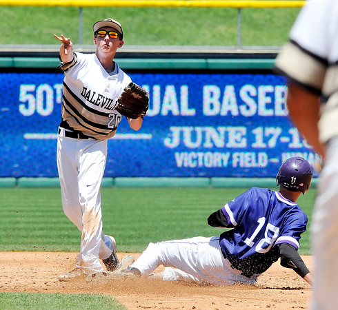 John P. Cleary   The Herald Bulletin<br /> Daleville second baseman Gavin Whitmore throws to first to complete a double play to end the fifth inning and put out a Lanesville scoring threat.