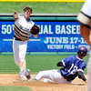 John P. Cleary | The Herald Bulletin<br /> Daleville second baseman Gavin Whitmore throws to first to complete a double play to end the fifth inning and put out a Lanesville scoring threat.