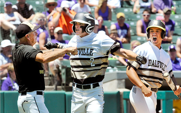 John P. Cleary | The Herald Bulletin<br /> Daleville's TJ Price, center, is pumped up after hitting a home run giving Daleville the lead in the forth inning.