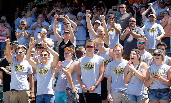 John P. Cleary   The Herald Bulletin<br /> Daleville fans cheer and wave as the team showed off the state championship trophy to them.