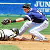 John P. Cleary | The Herald Bulletin<br /> Daleville's Corbin Maddox dives back to second base on a pickoff play after hitting a double in the 3 inning.