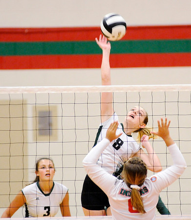 Don Knight | The Herald Bulletin<br /> Pendleton Heights Averi Lanman attacks the ball as the Anerson Indians hosted the Arabians on Wednesday.