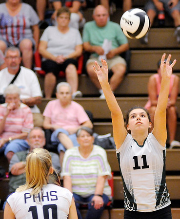 Don Knight | The Herald Bulletin<br /> Pendleton Heights Aubree Dwiggins sets the ball for Gracie King as the Anerson Indians hosted the Arabians on Wednesday.