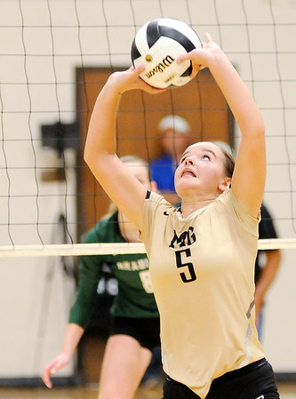 Don Knight | The Herald Bulletin<br /> Madison-Grant's Brooke Butcher sets the ball as the Argylls hosted Pendleton Heights on Thursday.